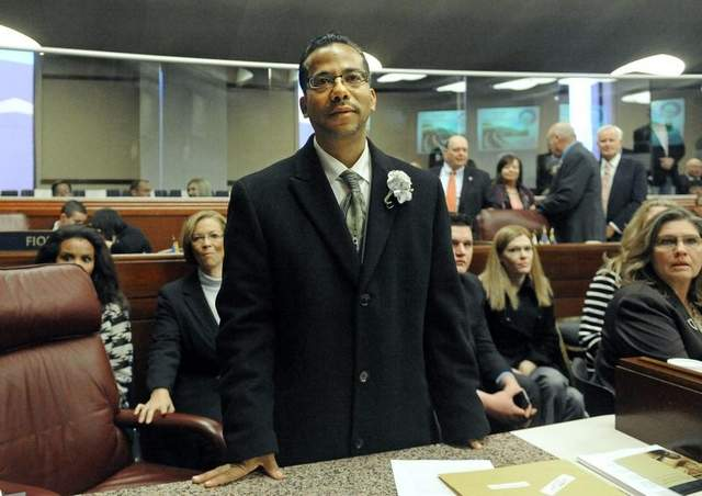 Assemblyman Steve Brooks stands at his desk at the Assembly Chambers Gallery on Feb. 4, 2013. / Andy Barron / RGJ