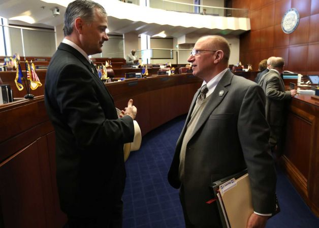 Sens. James Settelmeyer, left, and Joe Hardy talk on the Senate floor at the Legislative Building in Carson City on March 25, 2013. Both lawmakers introduced bills related to concealed weapon permits on Monday. (AP Photo/Cathleen Allison)