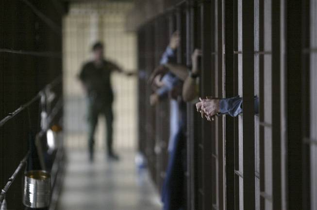 A correctional officer talks with inmates in the Cellhouse at the Nevada State Prison in Carson City, on Friday, Feb. 11, 2005. CATHLEEN ALLISON / AP