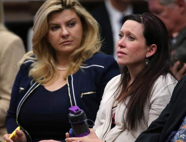 Assemblywoman Michelle Fiore, left, and Amanda Collins listen to testimony on a bill that would allow permit holders to carry their guns on college campuses during a hearing at the Legislative Building on April 3, 2013. (AP Photo/Cathleen Allison)