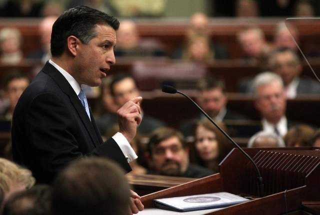 Republican Gov. Brian Sandoval has vetoed legislation that would have changed citywide voting to ward-only voting and is expected to veto a bill that would require a background check on private gun sales. Cathleen Allison/AP file