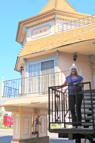 Marilyn Fink stands in front of the Victorian Inn in Sparks, Nev. / Photo by Molly J. Moser