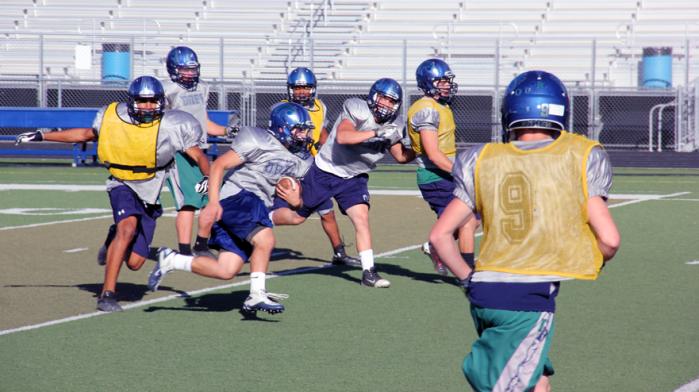 The Damonte Ranch Mustangs have football practice at Damonte Ranch High School on Oct. 8, 2013. / Photo by Nicholas Stack