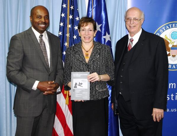 RSJ Associate Professor Ben Holden with U.S. Ambassador Tracey Jacobson and Ron Keefover, recently retired public information officer of the Kansas Supreme Court. / Courtesy photo