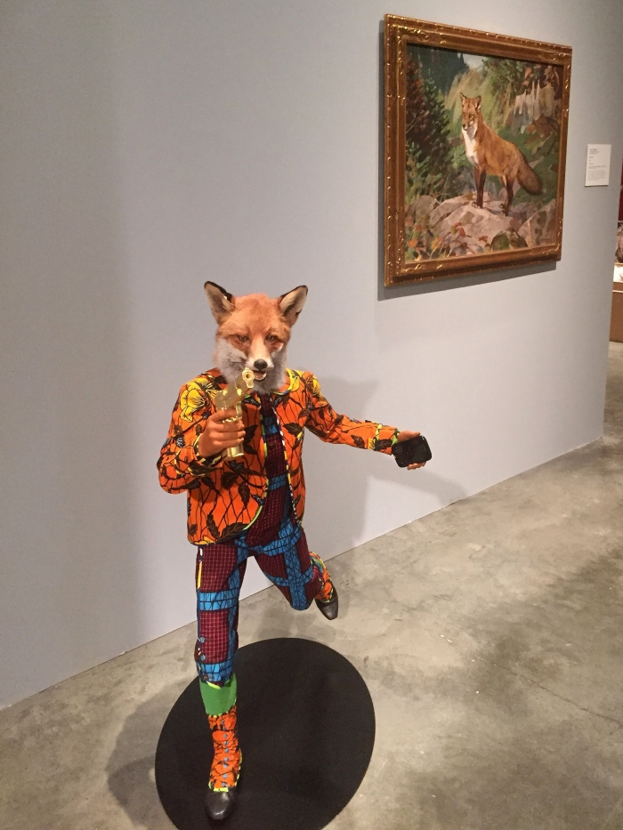 "Yinka Shonibare's ""Revolution Kid (Fox)"" in front with Carl Rungius' ""Red Fox"" in the back. Both pieces use foxes, each asking different questions of it's audience."
