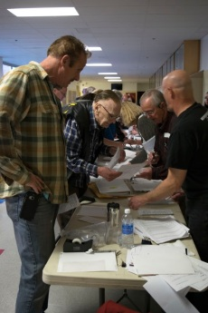 Volunteers help caucus attendees register and find their precinct in order to participate in the Nevada Republican Caucus on Feb. 23.
