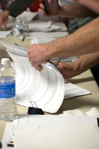 Volunteers look through documents in order to help attendees find their precinct to participate in the Nevada Republican Caucus on Feb. 23.