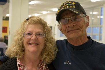 """Charlotte Knowlton stands with her husband after having cast their caucus vote for Marco Rubio. """"He's young, he's intelligent, he's a man of faith. We think we need some young blood. He stands for the Constitution."""" They were split between voting for Rubio and for Ted Cruz. """"We wish they'd run together! They've got to stop this ISIS crap."""""""