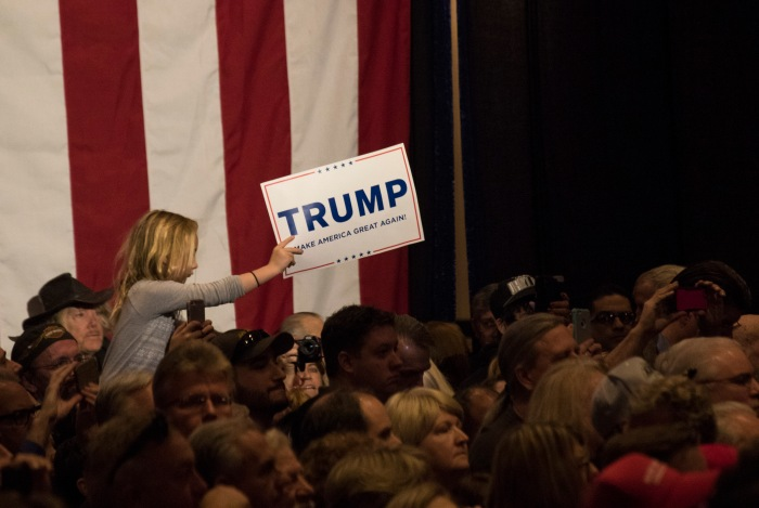 A child waves a Trump sign at a rally for Trump at the Nugget Casino Resort in Sparks, Nev. on Feb. 23, 2015.